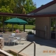 The courtyard between the dining hall and a resident building. Veterans can enjoy eating their meals outside during the sunny weather, or get together for a friendly conversation in a relaxing and supportive community environment.